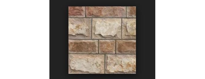 Фото облицовки из плитки псковского известняка с пятисторонней обработкой серого и коричневого цвета