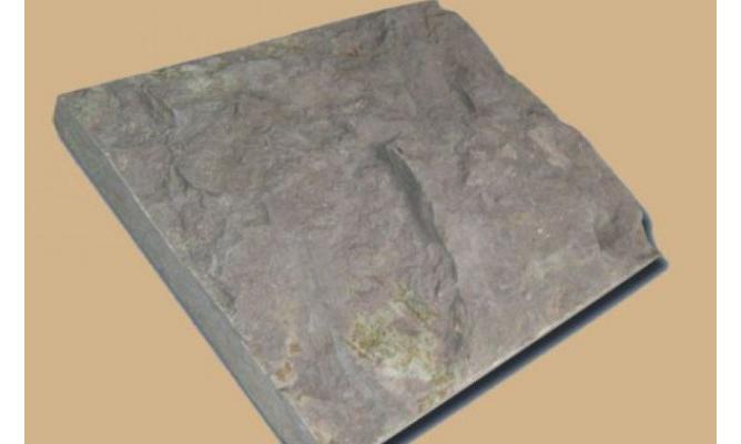 Фото плитки серого рельефного александровского известняка
